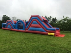 Red & Blue 60Ft Donegal Bouncy Castle Hire